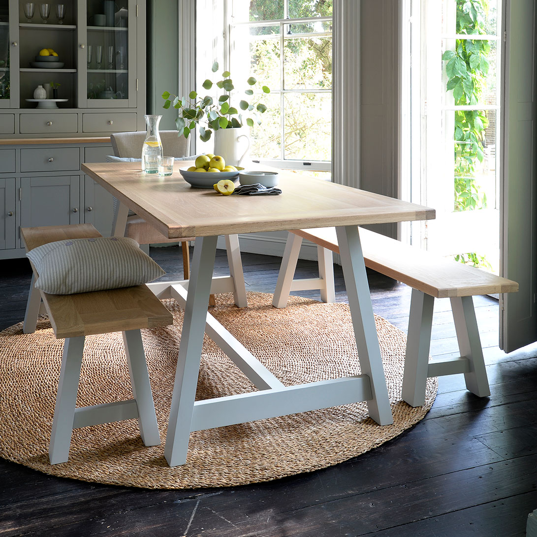 Chester Grey Large Trestle Table with 2 Benches, Cushion, glassware, bistro carafe,