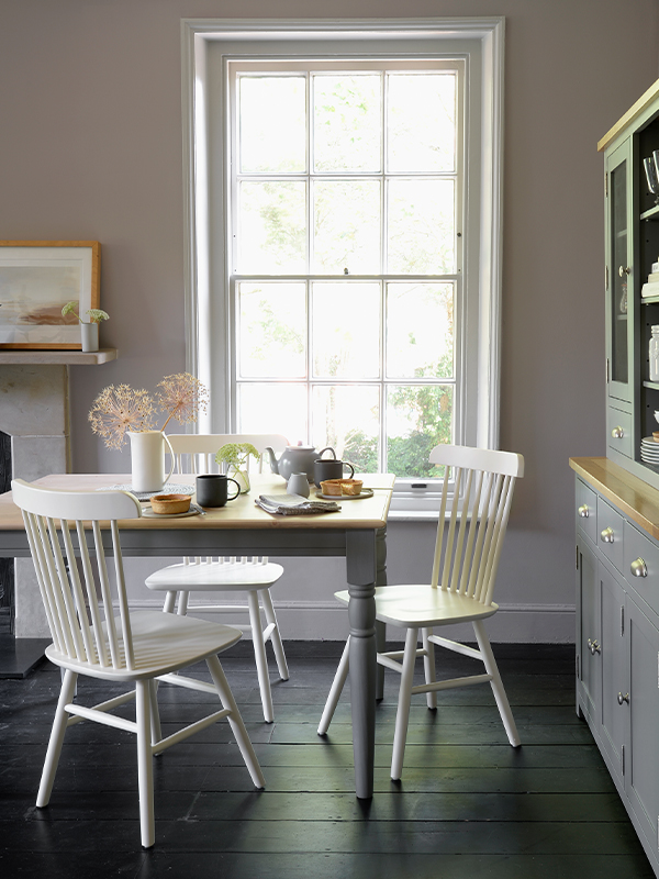 Dining Furniture, Farmhouse Storm Grey dining table, Aston Pure White Spindleback Chairs, artificial flowers, Sussex Storm Grey Dresser, Dining table and chairs