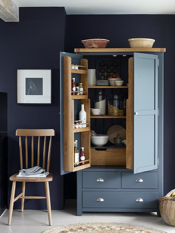 Kitchen furniture, larder cupboard, kitchen chair, Westcote Inky Blue Double Larder, Elkstone Oak spindleback kitchen chair,jute rug, kitchenware.